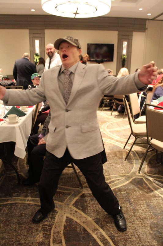 Man dancing at the Holiday Tea