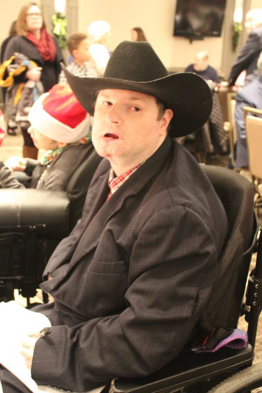 Man in cowboy hat at Holiday Tea event