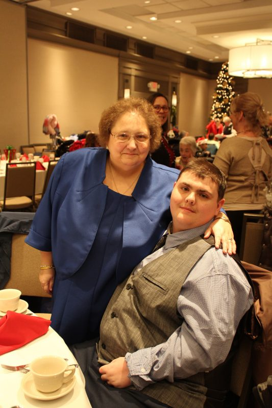 Mother and son at the Holiday Tea event