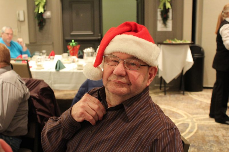 Man in a Santa hat at the Holiday Tea event