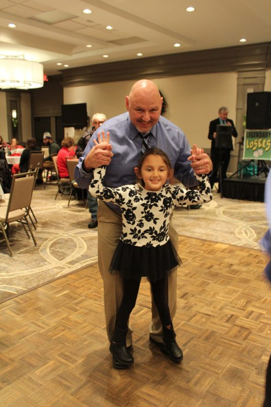 Father and daugther dancing at the Holiday Tea party