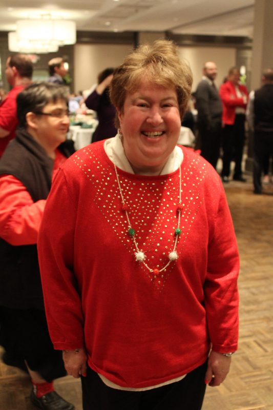 Woman on the dance floor at the Holiday Tea event
