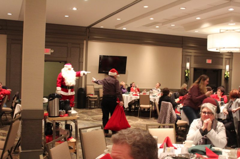 Santa entering the room at the Holiday Tea party