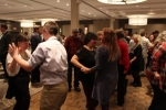 People dancing at the Holiday Tea event