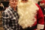 Man smiling with Santa at the Holiday Tea party