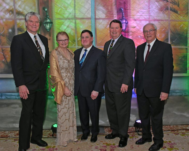 "L-R: Director of Public Relations Walt Adams, Senior Director & Chief Compliance Officer June MacClelland, Executive Director Chris Lyons, Board Member and Fundraising Chair Brian Gwynn, Board President Martin ""Buddy"" Glastetter at Mardi Gras for AIM Services"