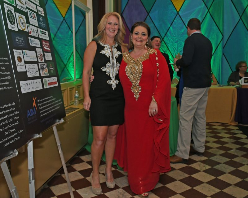 Gala Co-Chairs Heather Straughter and Beth Alexander at Mardi Gras for AIM Services