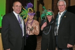 Two couples enjoying Mardi Gras for AIM Services