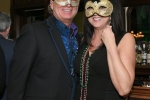 Couple with silver and gold masks on at Mardi Gras for AIM Services