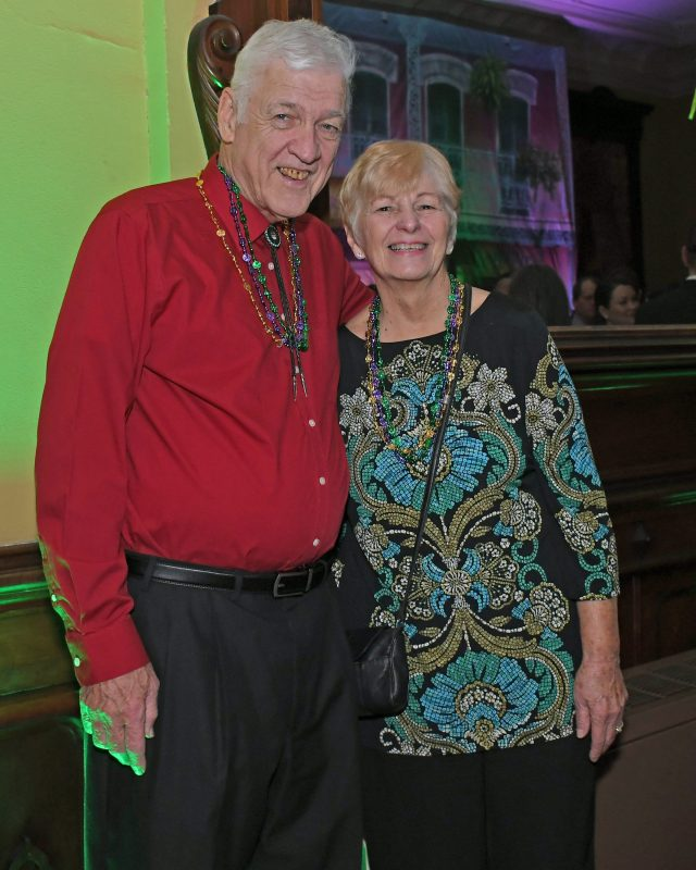 Couple smiling at Mardi Gras for AIM Services