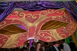 Large mask decoration at Mardi Gras for AIM Services