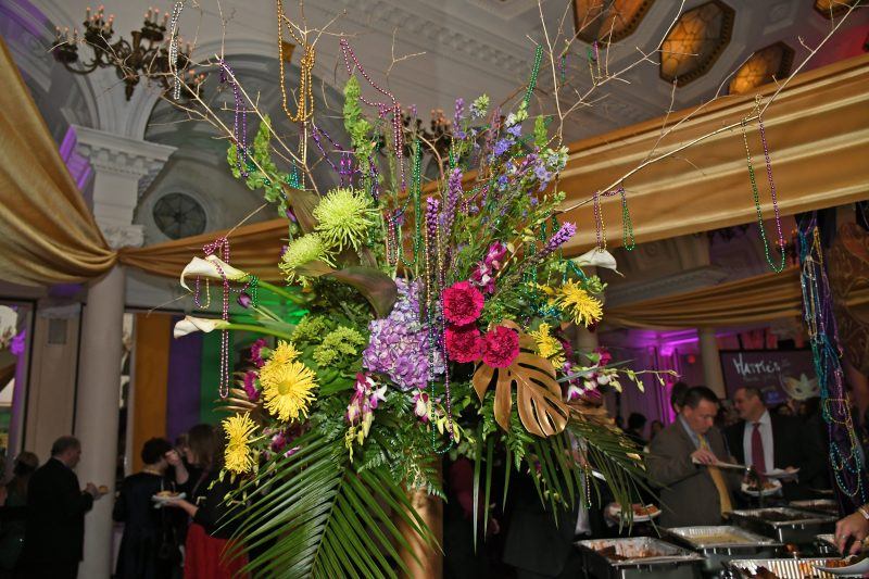 Flower arrangement with beads at Mardi Gras for AIM Services