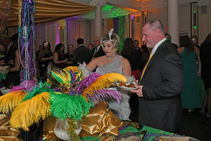 Couple at buffet at Mardi Gras for AIM Services