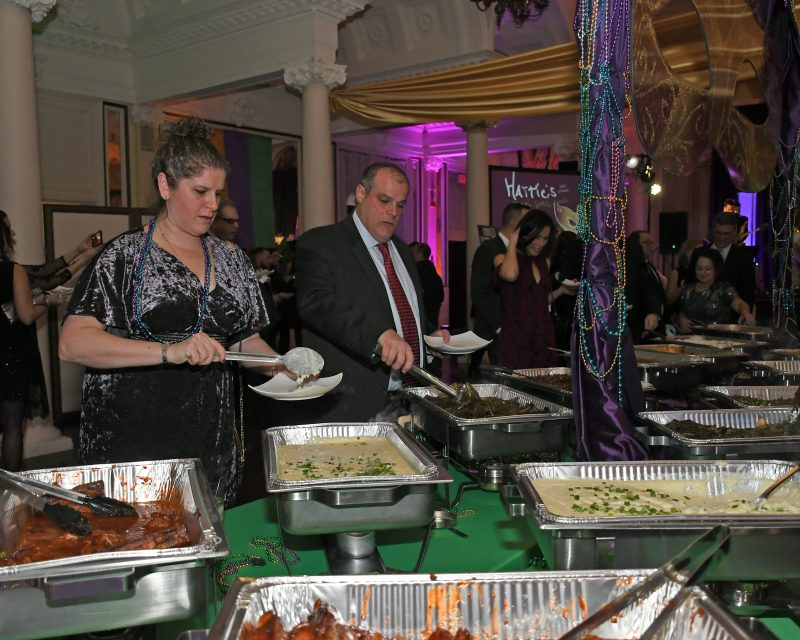 People at food buffet at Mardi Gras for AIM Services