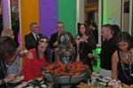 Group of people at crawfish, oyster and shrimp buffet at Mardi Gras for AIM Services