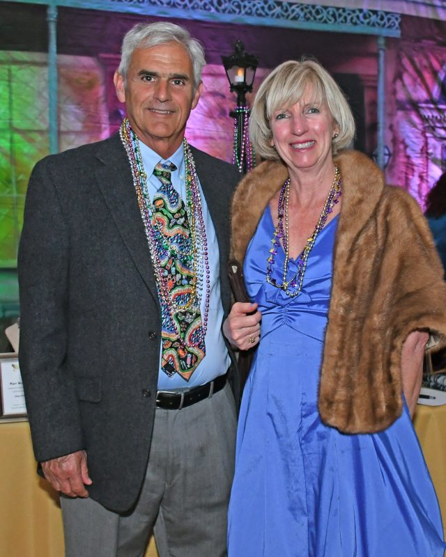 Couple with beads at Mardi Gras event for AIM Services