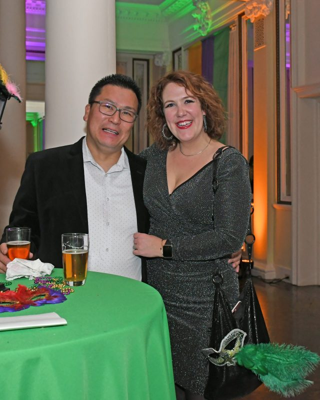 Attendees at Mardi Gras event for AIM Services