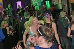 People dancing at Mardi Gras event for AIM Services