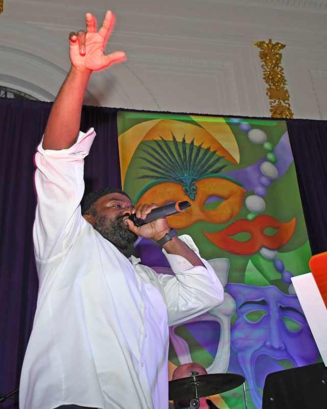 Garland Nelson singing at Mardi Gras for AIM Services event