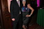 Couple in masks at Mardi Gras event for AIM Services