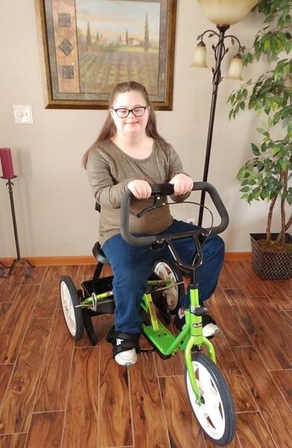 girl on adaptive bicycle