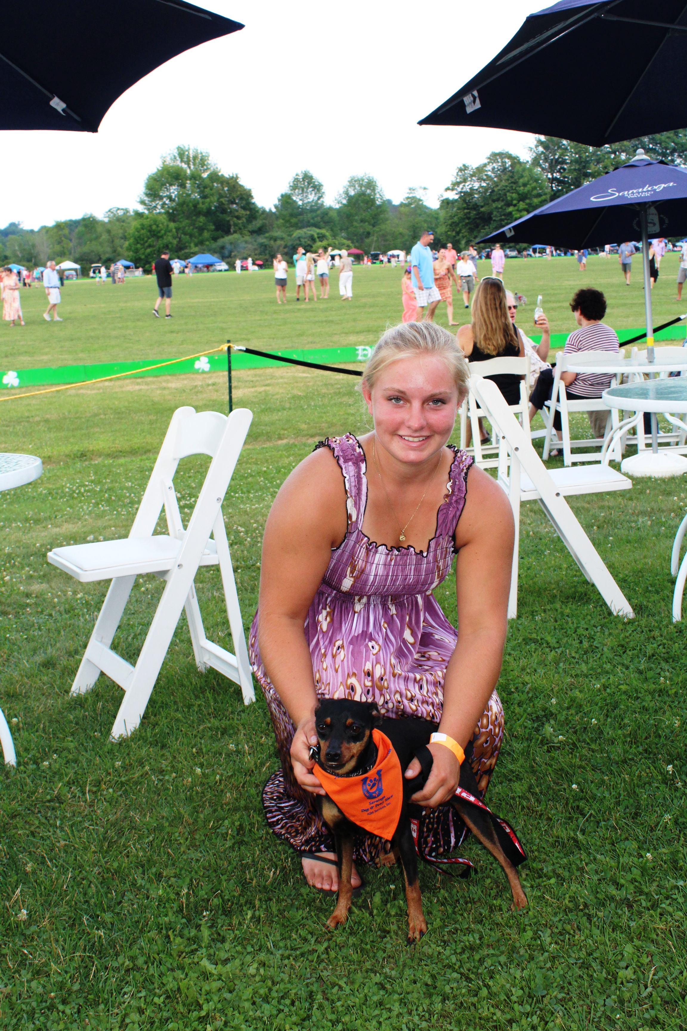 Girl with dog at the Saratoga Dog & Pony Show to benefit AIM Services, Inc.