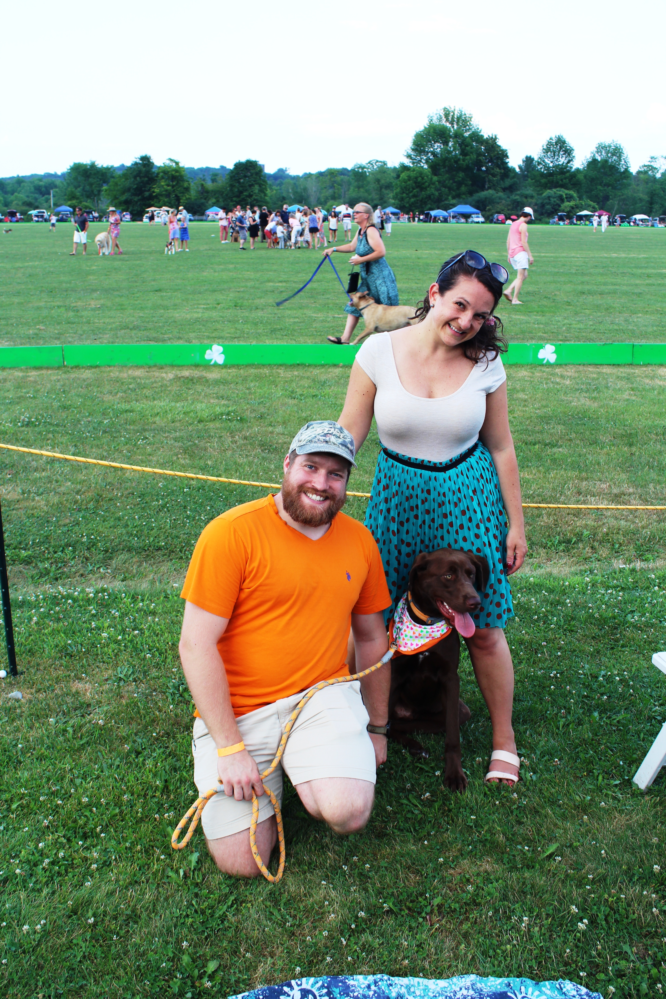 Couple with chocolate lab at the Saratoga Dog & Pony Show to benefit AIM Services, Inc.