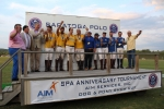 Polo teams on stage cheersing at the Saratoga Dog & Pony Show to benefit AIM Services, Inc.