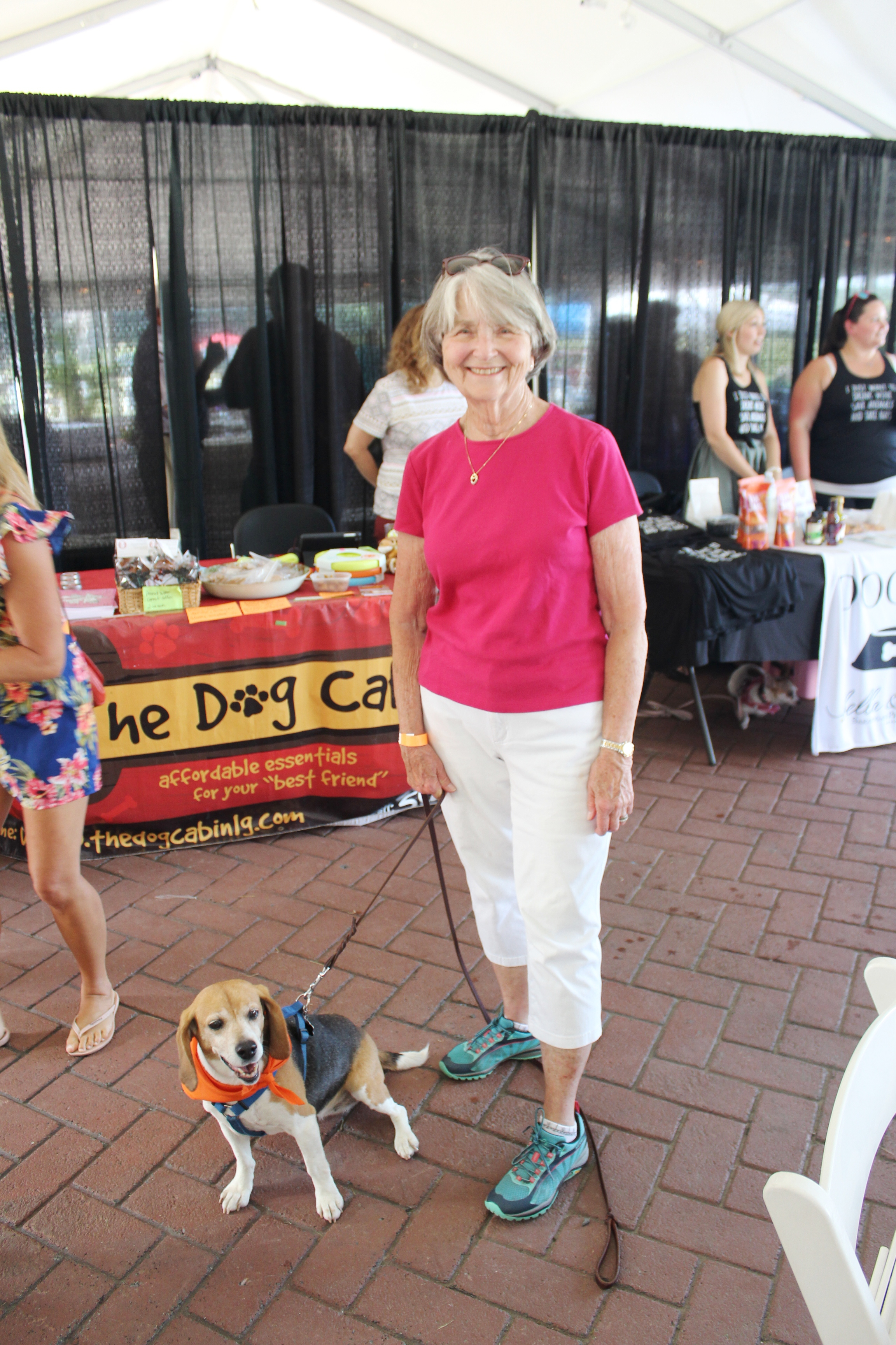 Woman with dog smiling at the Saratoga Dog & Pony Show to benefit AIM Services, Inc.