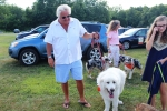 Man with big dog at the Saratoga Dog's Pony Show to benefit AIM Services, Inc.