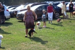 Woman doing trick with dog at the Saratoga Dog's Pony Show to benefit AIM Services, Inc.