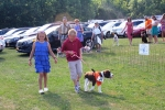 Two kids walking dog at the Saratoga Dog & Pony Show to benefit AIM Services, Inc.