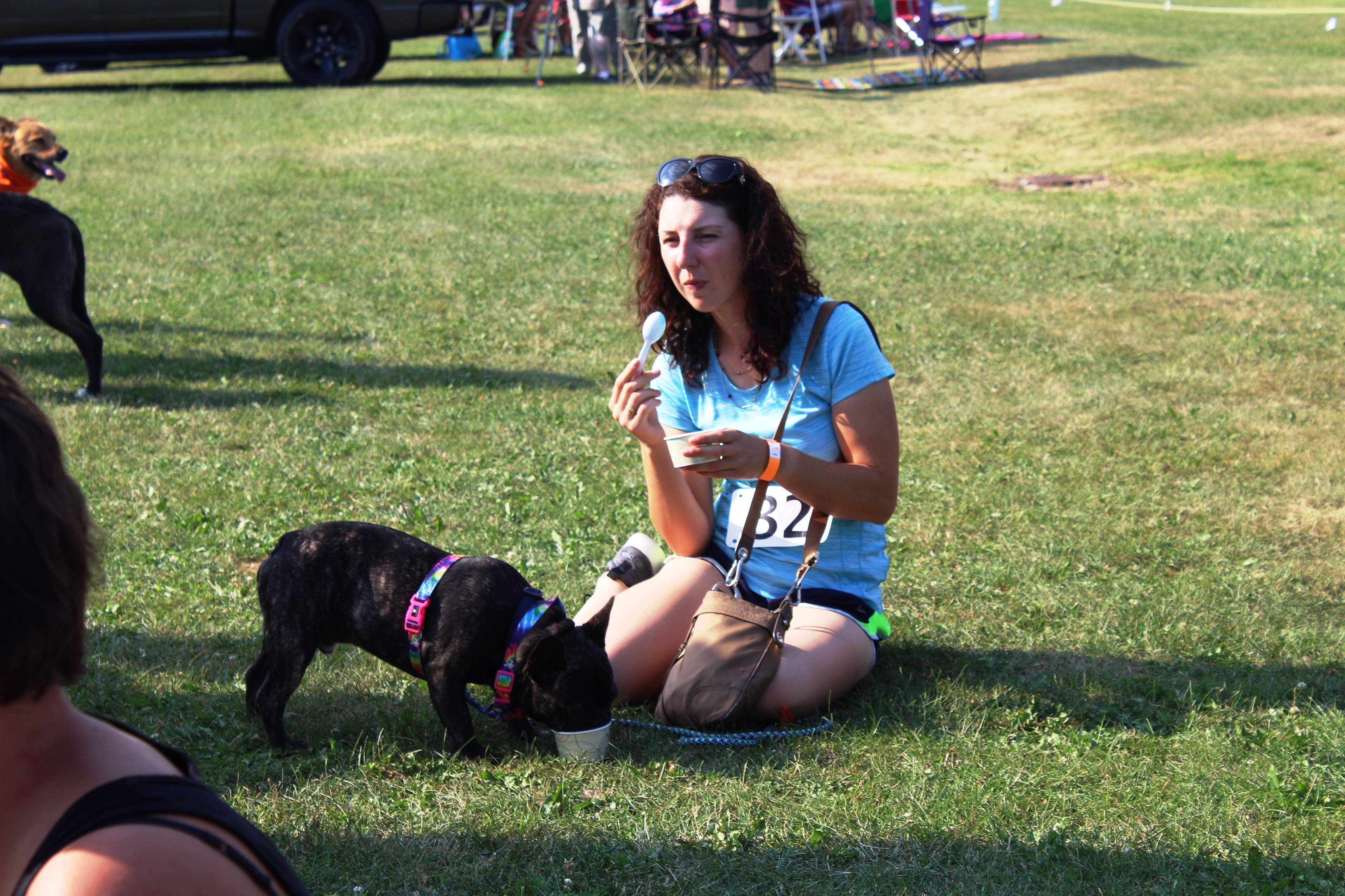 Woman and dog both eating Dairy Haus ice cream at the Saratoga Dog & Pony Show to benefit AIM Services, Inc.