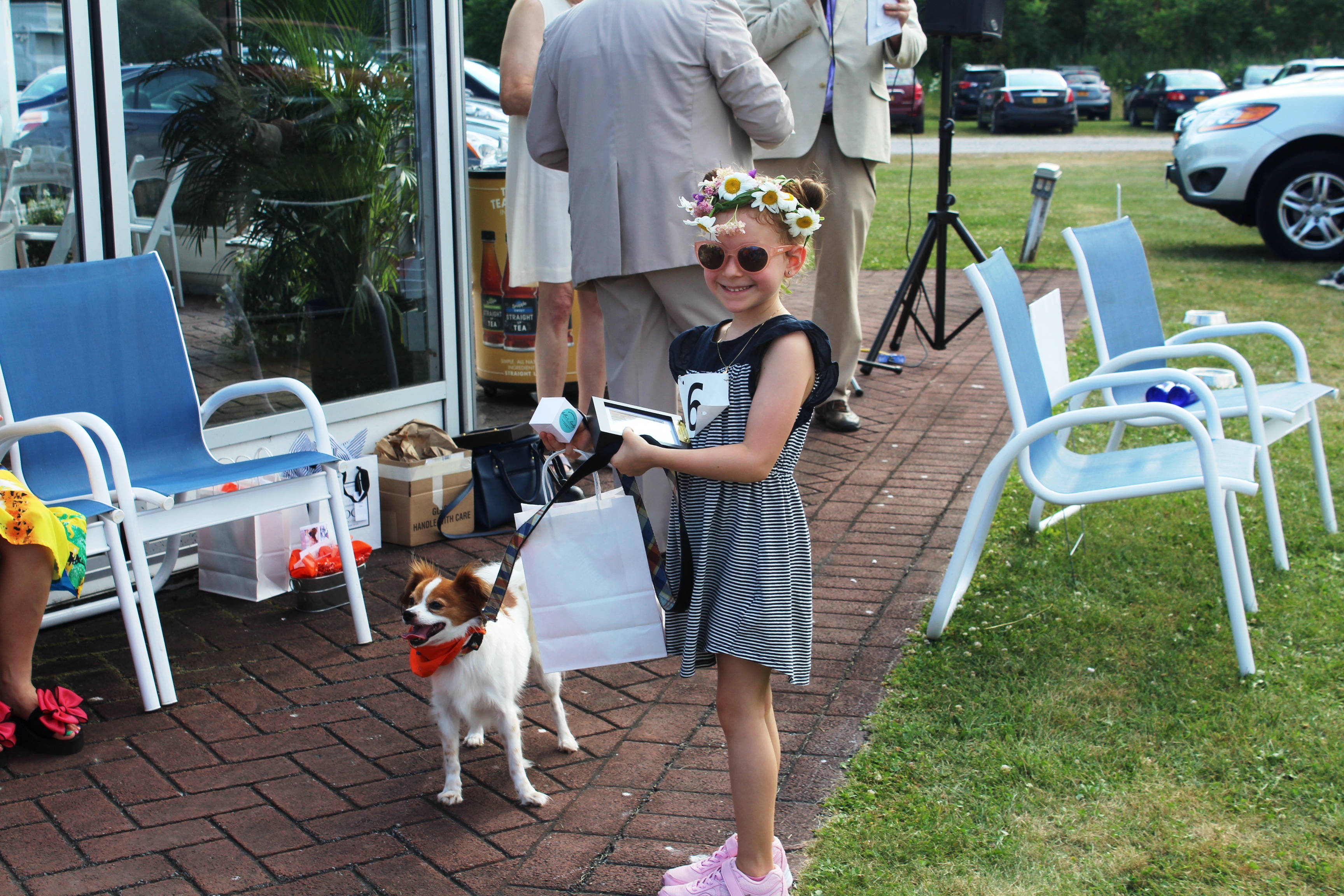 Young girl with small dog winning prize at the Saratoga Dogs Pony Show to benefit AIM Services, Inc.