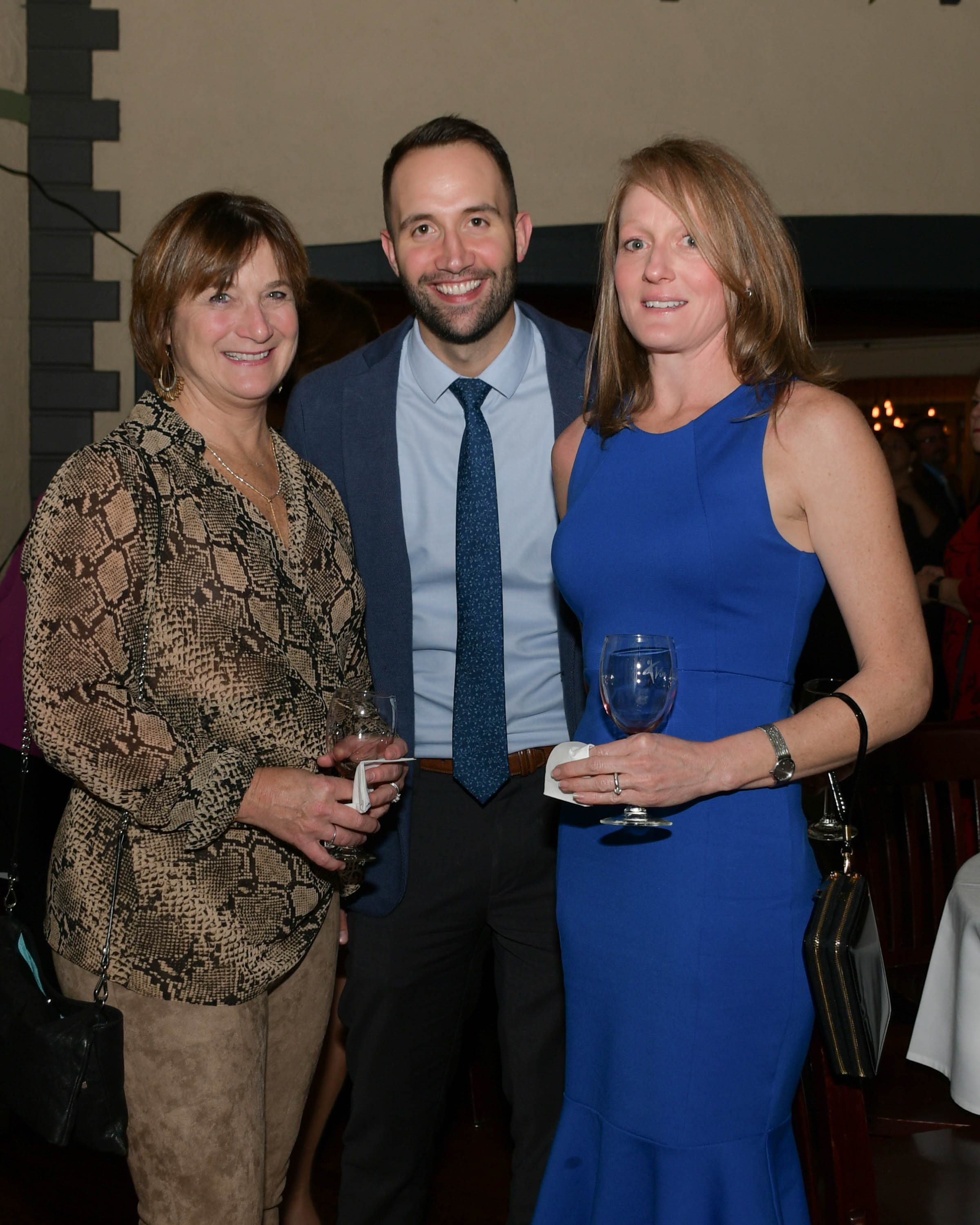 Vin Le Soir to benefit AIM Services, Inc. three people with wine