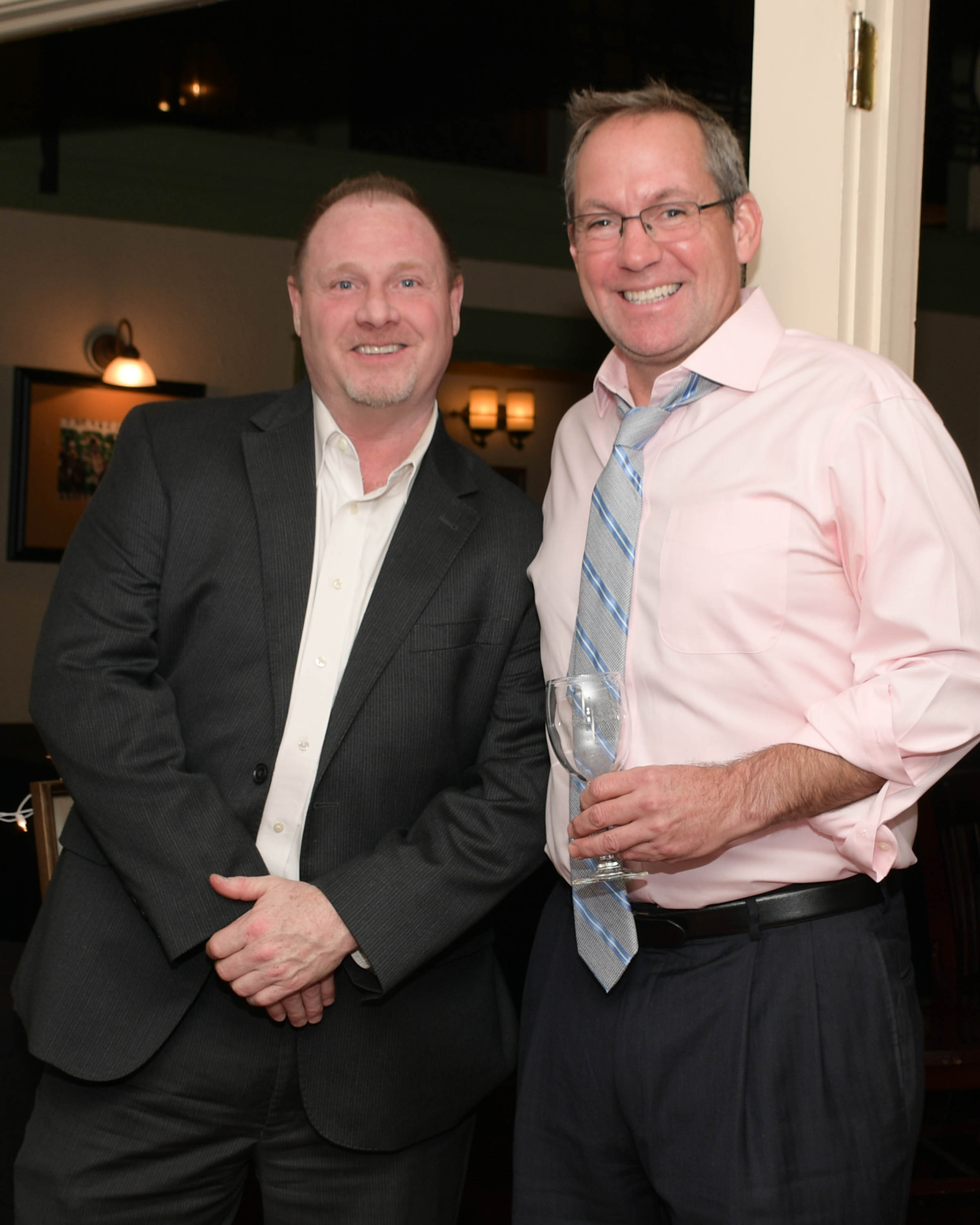 Vin Le Soir to benefit AIM Services, Inc. two men at event