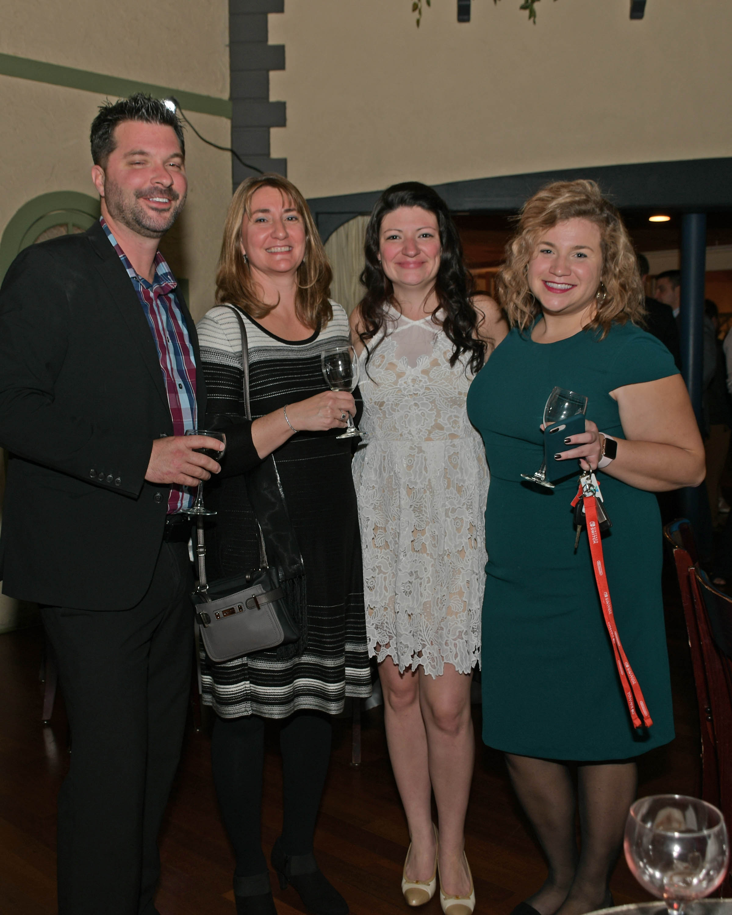 Vin Le Soir to benefit AIM Services, Inc. four people at AIM wine event