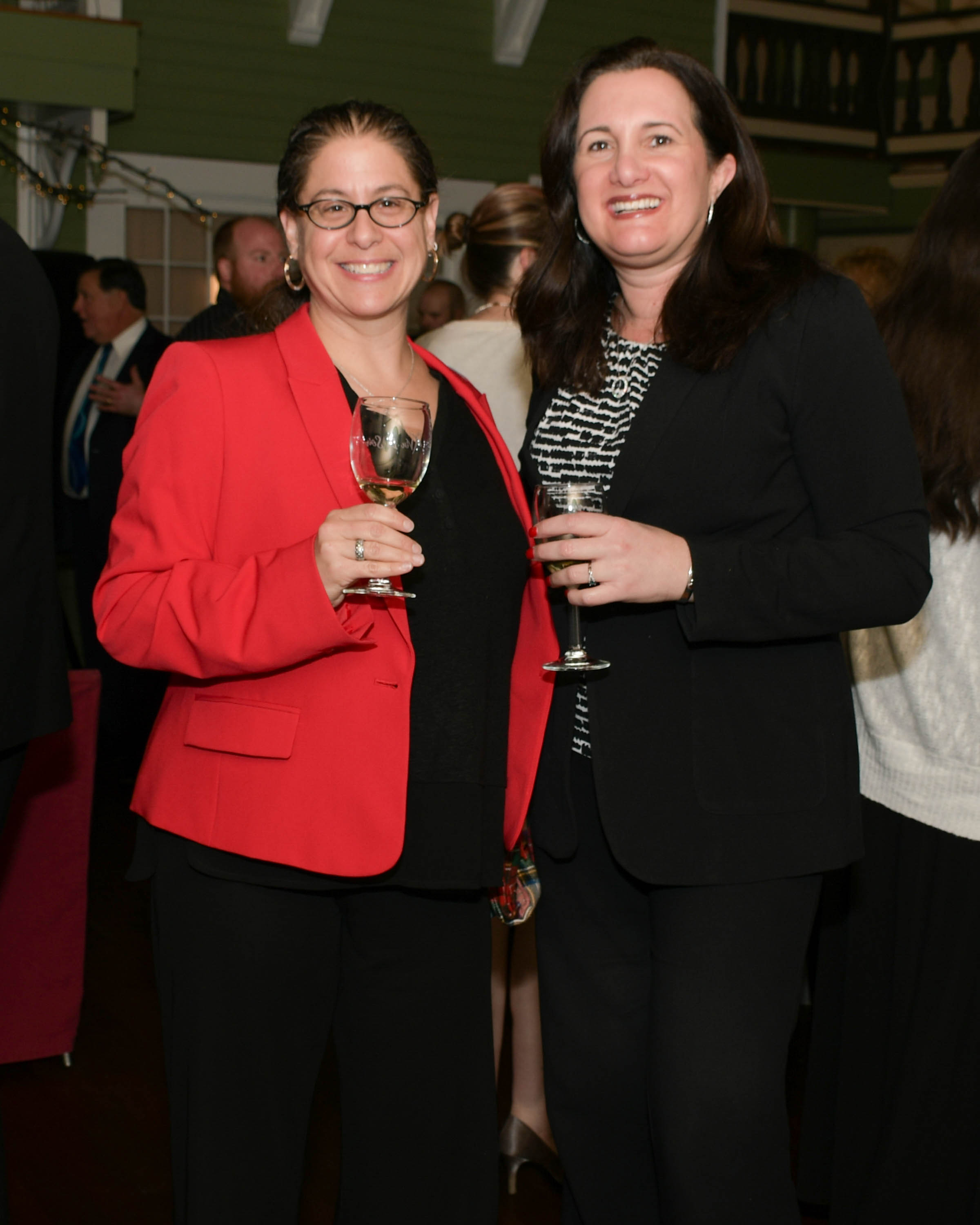Vin Le Soir to benefit AIM Services, Inc. two women with wine at AIM event