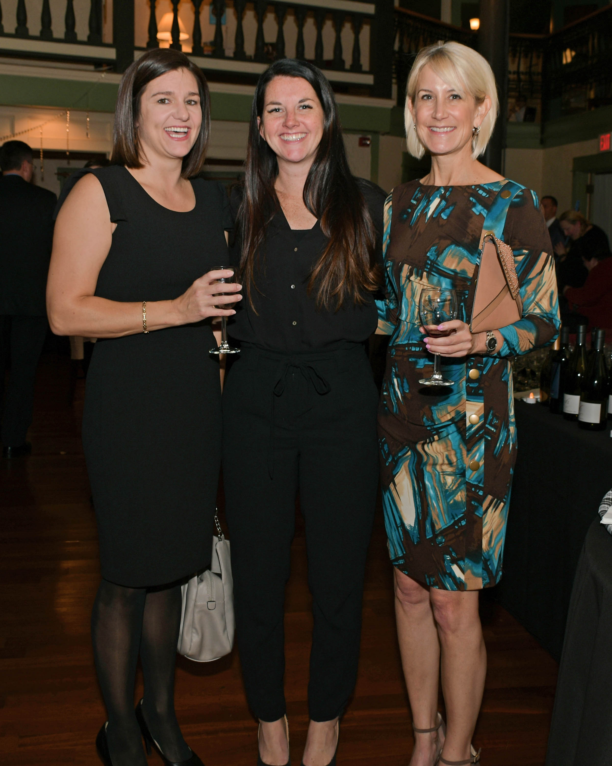 Vin Le Soir to benefit AIM Services, Inc. three women with wine at AIM event