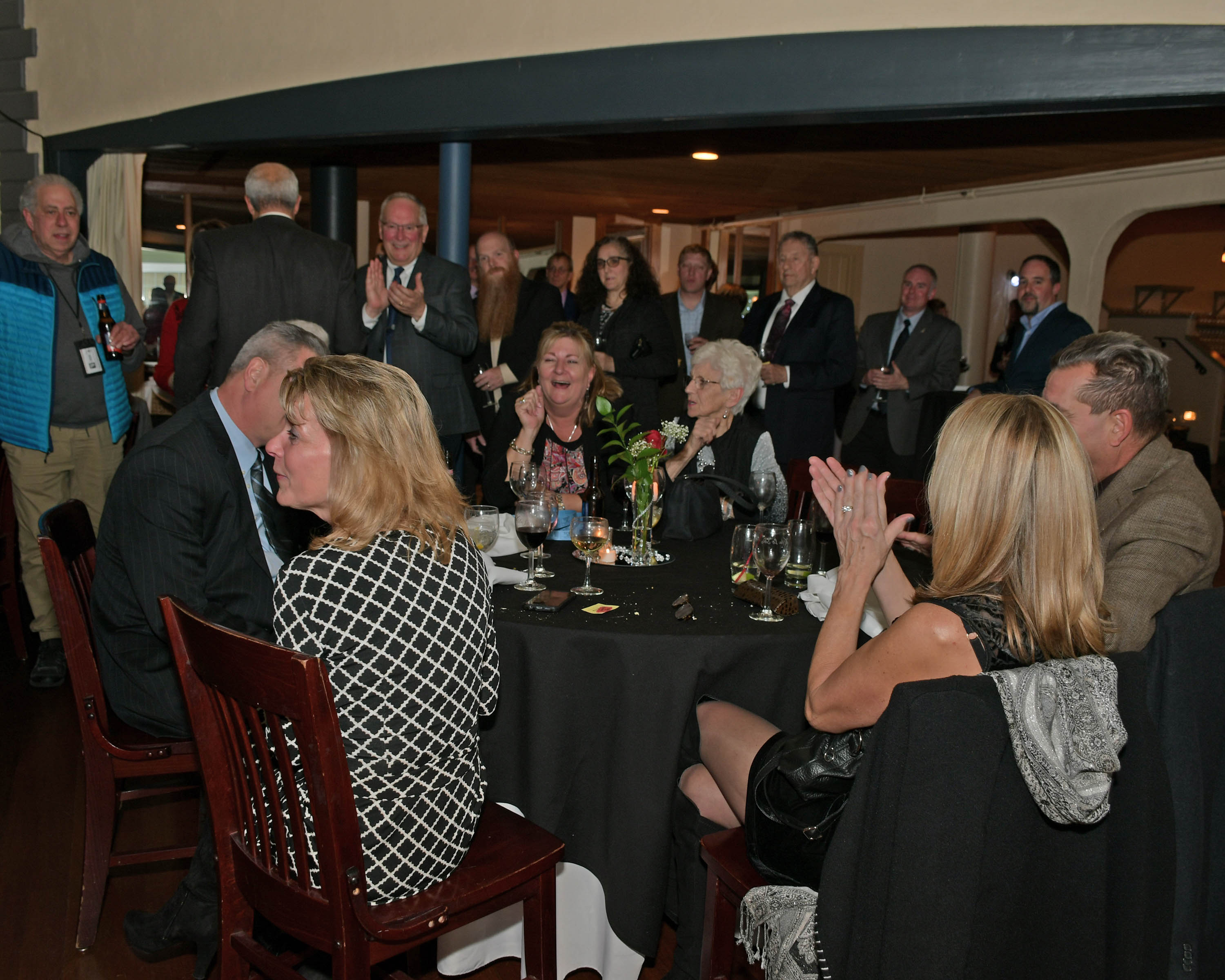 Vin Le Soir to benefit AIM Services, Inc. group of people at table for wine tasting