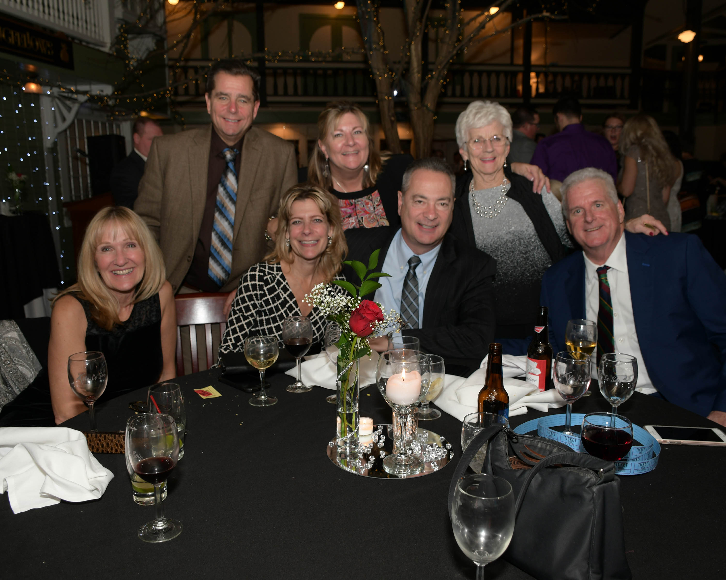 Vin Le Soir to benefit AIM Services, Inc. group of people tasting wine at table