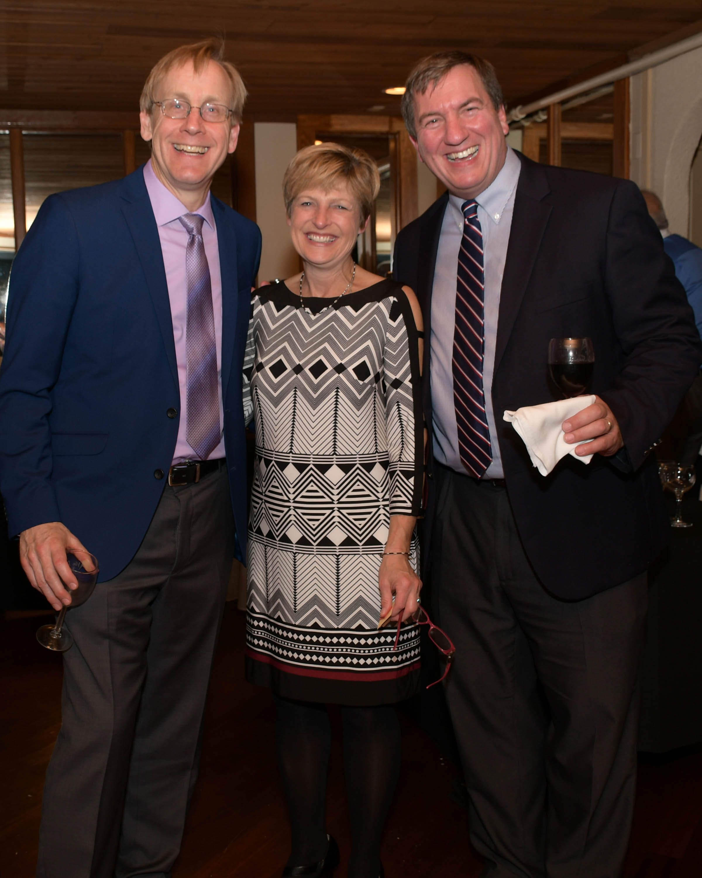 Vin Le Soir to benefit AIM Services, Inc. group of three people at wine tasting