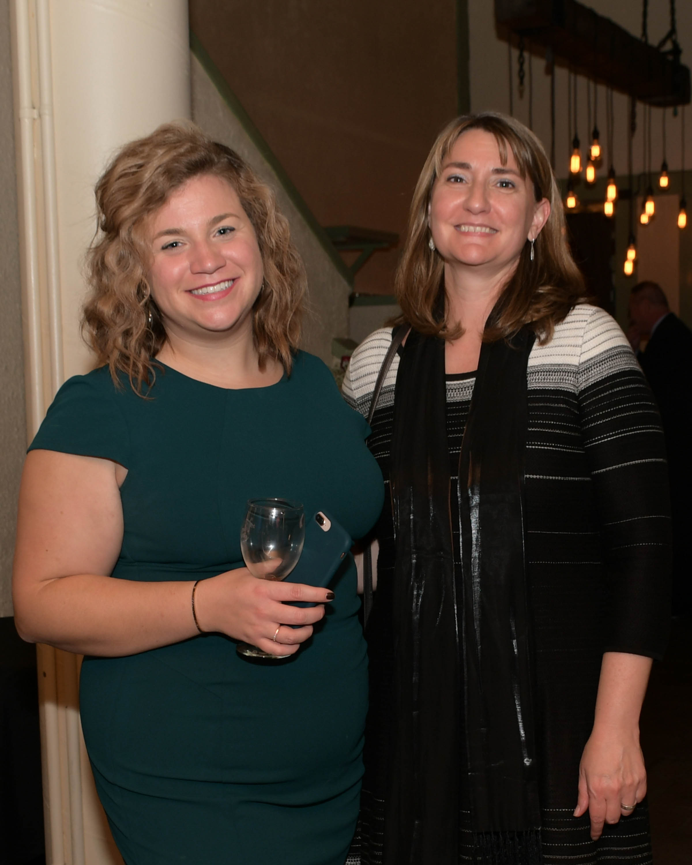 Vin Le Soir to benefit AIM Services, Inc. two women