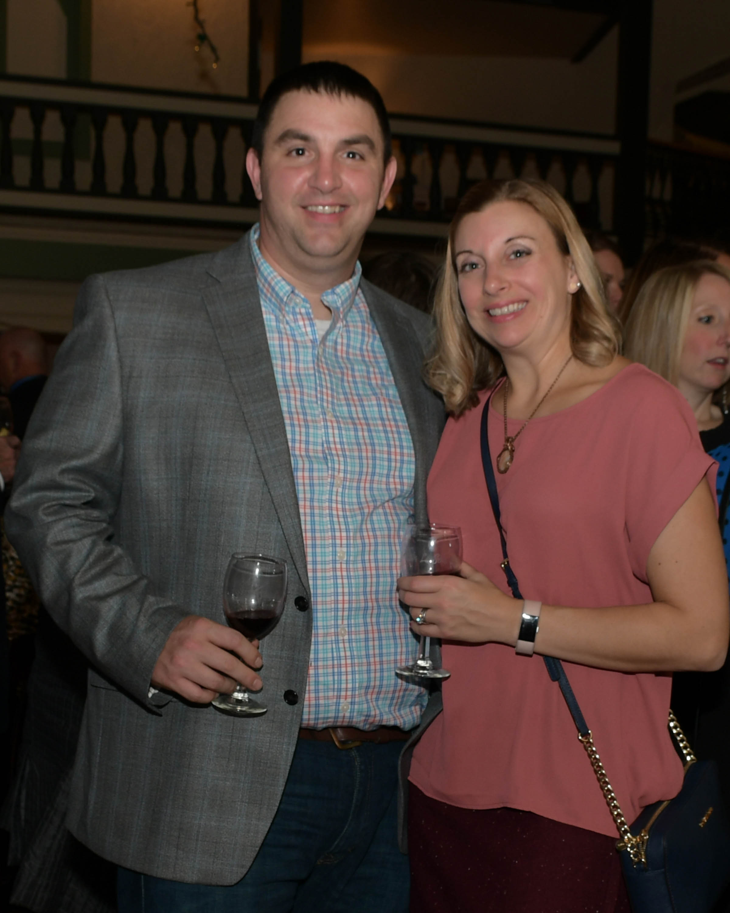 Vin Le Soir to benefit AIM Services, Inc. couple at event with wine