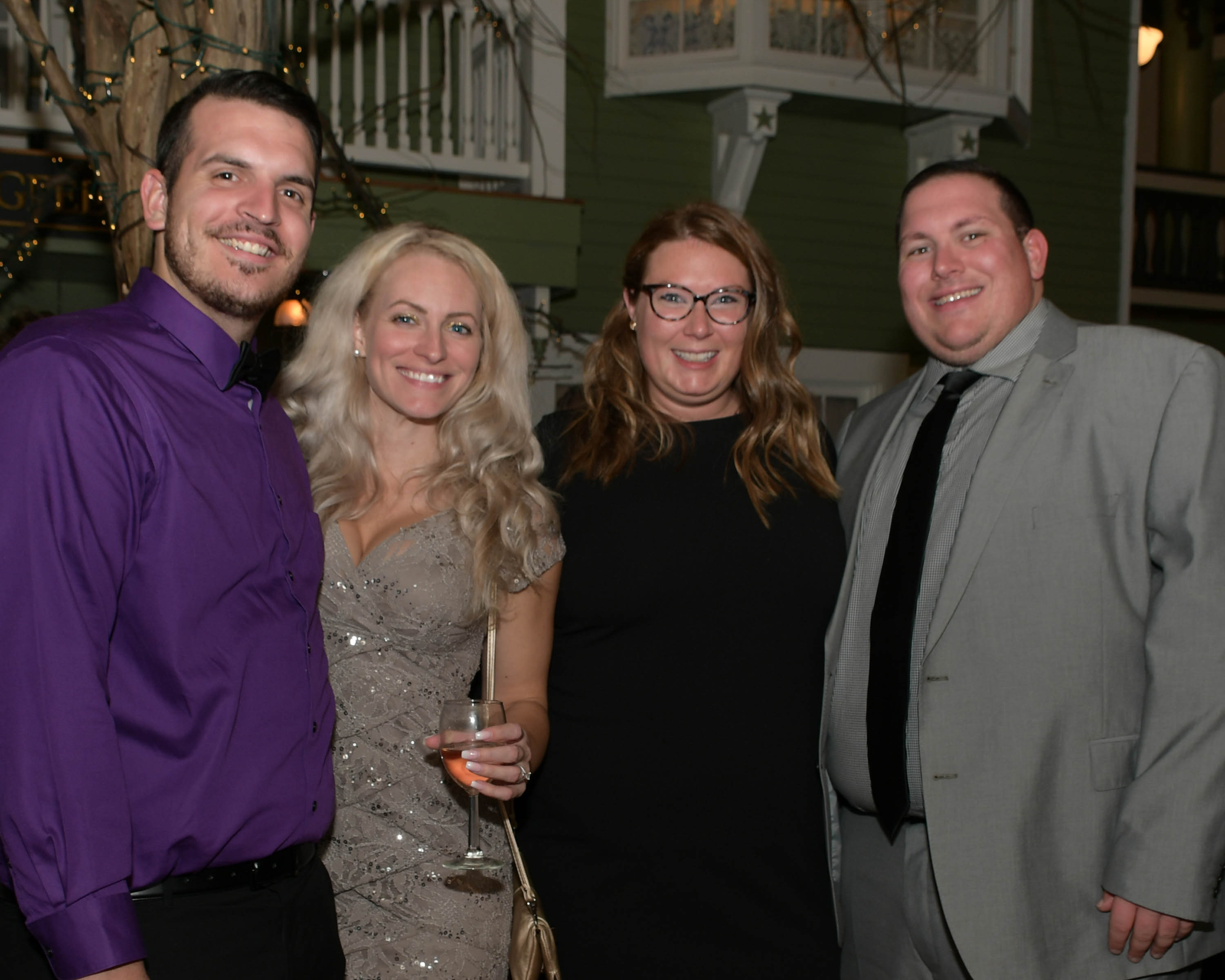 Vin Le Soir to benefit AIM Services, Inc. group of four people