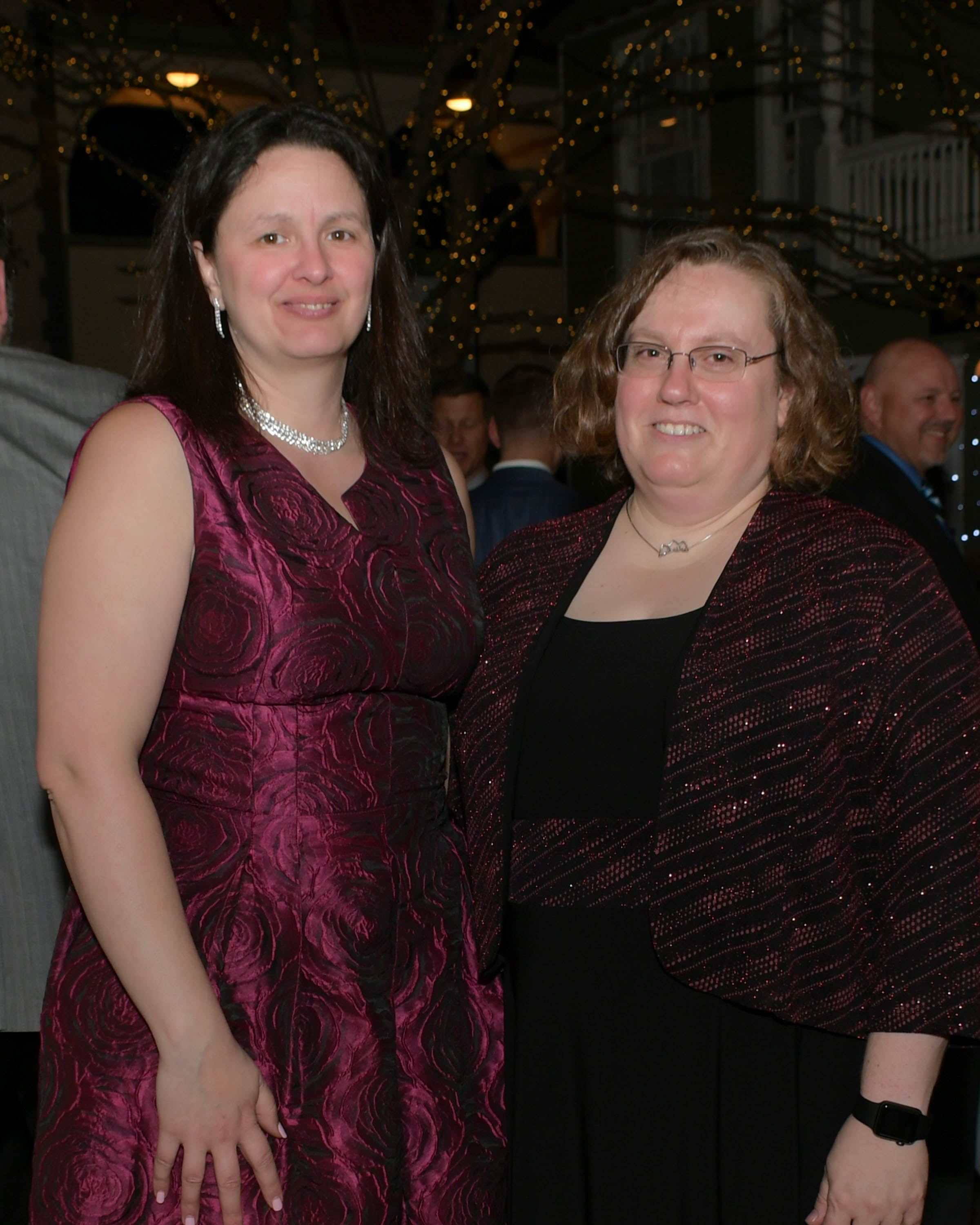 Vin Le Soir to benefit AIM Services, Inc. two women at event