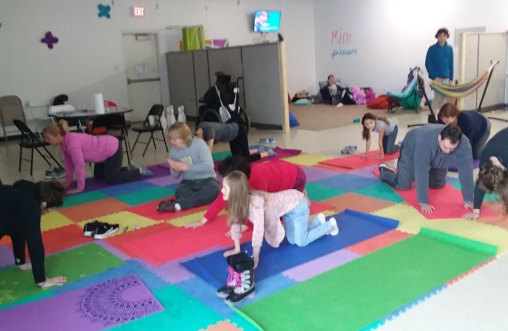 group of young kids doing yoga