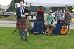 Woman playing bagpipes at AIM Services Croquet on the Green event