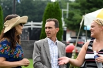 Ramon Domniguez and wife talking with AIM staff at AIM Services Croquet on the Green event