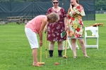 Group of three women playing croquet at AIM Services Croquet on the Green event